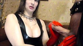 Masked brunette lady in latex delivers a marvelous footjob