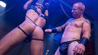 Mild bondage scene of two sexy gay dudes