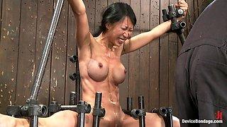 Extreme bondage with Asian Tia Ling getting toyed