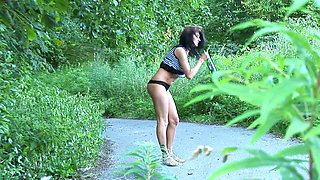 Horny brunette lets the yellow liquid flow out and she's so hot