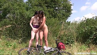Lesbian teen couple take a bike ride and lick each other outdoors