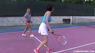 Busty teen and her tennis instructor have lesbian sex on court