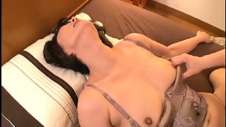 Busty Oriental housewife has a young man drilling her cunt