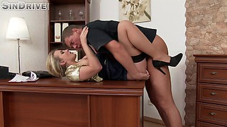 Alluring blonde in stockings sits down on the table and gets screwed