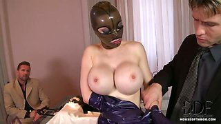 Latex Lucy Sucks On Two Cocks