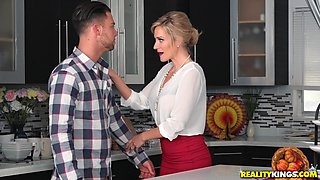 Evelin Stone and Blake Morgan feast on a cock in a kitchen