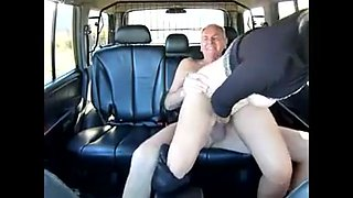 Young street hooker serves old man in his car