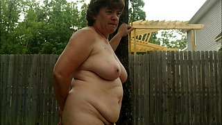 Hot granny stripteases and exposes her hairy peach outside