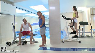 Two hunks fuck charming flat chested babe Stefanie at the gym