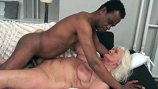 A granny that loves black cock is having interracial sex here