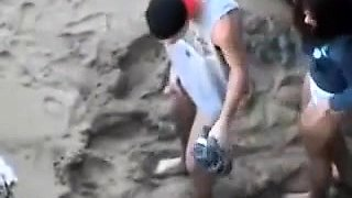 Wild brunette girlfriend gets banged doggystyle on the beach
