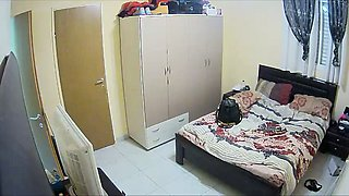 Watch amateur hidden cam video of lewd couple fucking on the wide bed