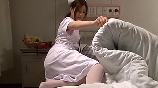 Japanese Nurse Comforts Her Patient