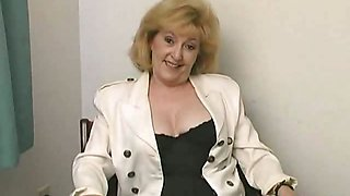 Lustful blonde grandma Kitty Fox stripping and showing her